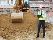 Mature man with clipboard on construction site