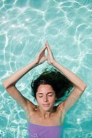 Serene woman in swimming pool