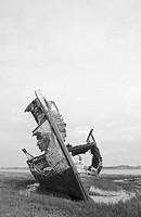 Rotting fishing boat on the sandbanks of the River Wyre estuary in Lancashire,England,UK