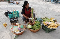 Thai Woman selling frech Fruits at the Beach in Hua Hin