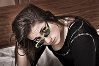 Teen girl wearing sunglasses