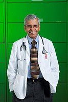 Image of doctor standing in front of file cabinets