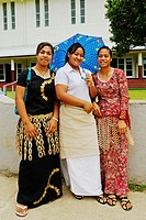 Tongan women in traditional dress outside church