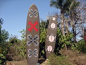 Tribal wooden boards and Tropical garden Port Aventura theme park Spain Catalonia Tarragona