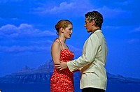 This teen couple April Hoag and Adam Bigelow are peforming a scene from the musical South Pacific in a romantic scene with a Hawaiian scenic in the ba...