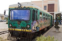 Railway station ALGHERO SARDINIA Graffiti painted train at terminus