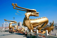 Golden dragon statues in front of Beijing Central Television Tower, Beijing, China