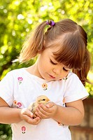 Little girl with chick