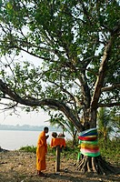 Monk praying. Mekong River. Vientiane. Laos.