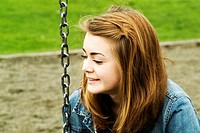 Fourteen year old girl in a playground in Vancouver, BC, Canada