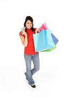 Excited Caucasian woman holding shopping bags and smiling on white background