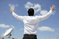 Businessman, young, shirt, white, back view, extended arms, rejoices,