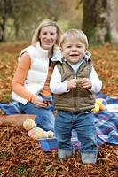 sitting, mother, young, baby, son, smiling, blankets, autumn leaves, blur, ,