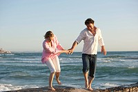 couple, middle age, vacation, beach, fun, boisterous, hold,