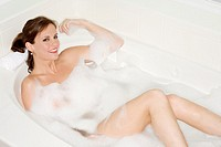 Beautiful Caucasian woman enjoying a nice bubble bath