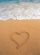 heart shape on sandy beach