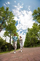 Couple running through park