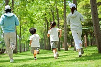 Family jogging together in the park