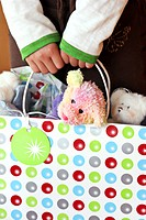 dolls in handheld shopping bag