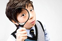 boy holding a magnifier