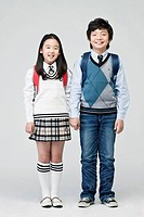 boy and girl carry a school bag over her shoulder