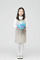girl holding a globe