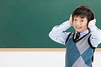 boy in front of blackboard