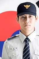 Police officer in front of Korean flag, Taegeukgi (thumbnail)