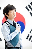 Boy in front of Korean flag, Taegeukgi (thumbnail)