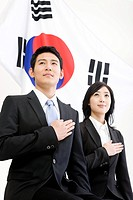businessman and businesswoman in front of Korean flag, Taegeukgi