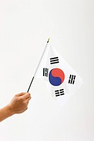 right hand holing Korean flag, Taegeukgi
