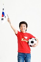Boy holing soccer ball and Korean flag, Taegeukgi (thumbnail)