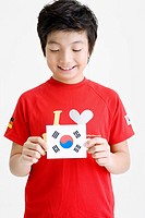 Boy holing Korean flag, Taegeukgi (thumbnail)