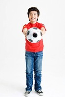 Boy holing soccer ball (thumbnail)