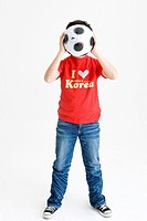 boy holing soccer ball