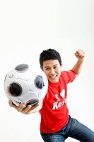 man holing soccer ball