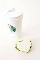 disposable cup of Starbucks and sandwich