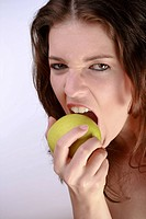Beautiful Woman Biting A Green Apple
