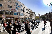 Pedestrians crossing King George V street in Jerusalem