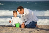Fort Lauderdale, Florida, United States Of America, A Father And Son Playing In The Sand On The Beach