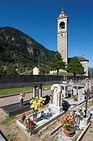 Cemetery in an alpine village  premia municipality  the church was build during the 15th century