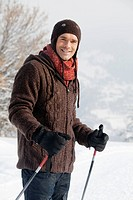 Male skier smiling at camera