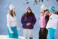 Four teenage girls in ski clothes