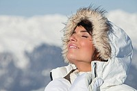 Young woman enjoying winter sun