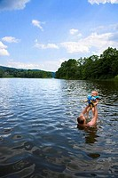 Man playing with his baby in a lake