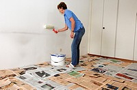Woman painting the walls of her apartement