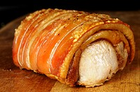 Roast pork joint on a wooden table