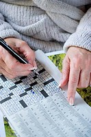 Senior woman solving a crossword puzzle