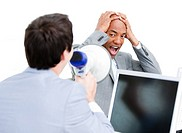 Caucasian businessman yelling through a megaphone in the office