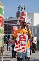 Detroit, Michigan - People picket Comerica Park during a baseball game between the Arizona Diamondbacks and Detroit Tigers to protest SB 1070, Arizona...